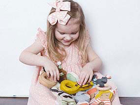 $75 to spend on Luxury Baby Toys & Accessories at Emy + Annie